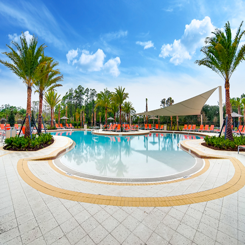 image of pool with shade structures over pool deck in the background