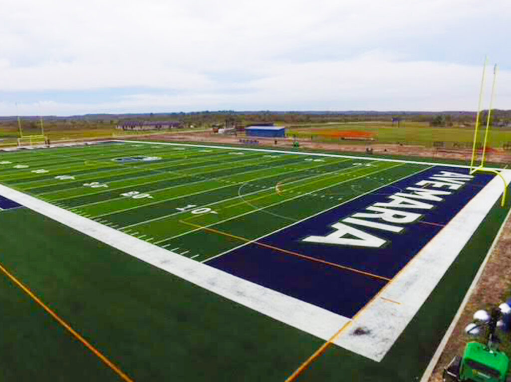 aerial image (corner of end zone) of outdoor synthetic turf football field