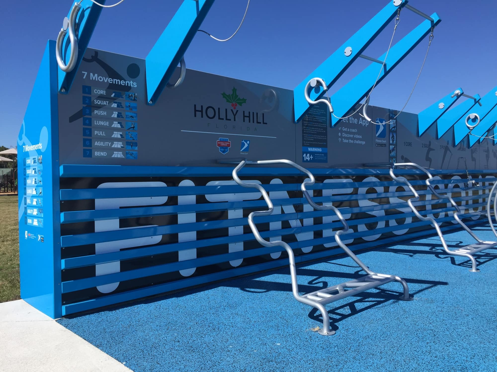 close up image of blue outdoor fitness center with equipment