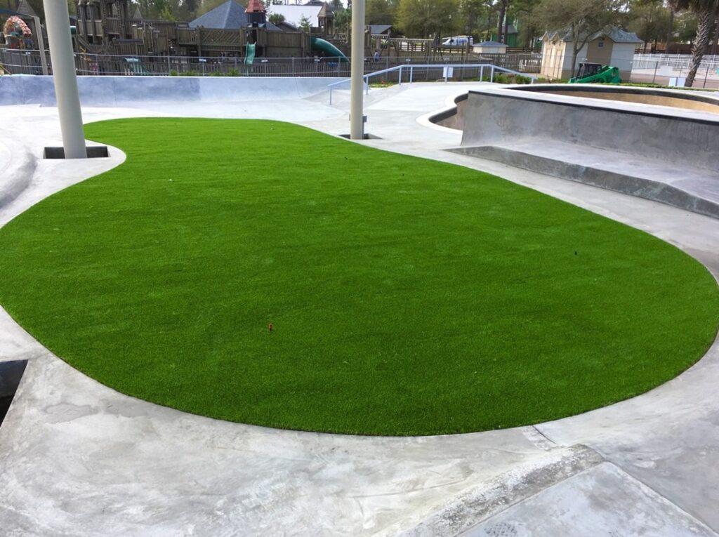 green turf area inside skate park tricks area