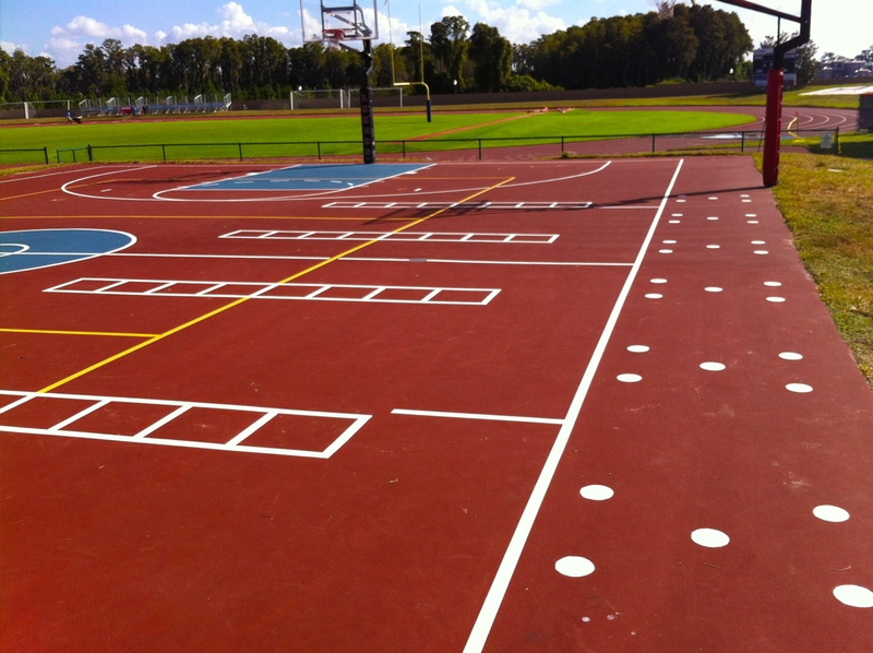 image of the outdoor basketball court, red court with white and yellow stripes
