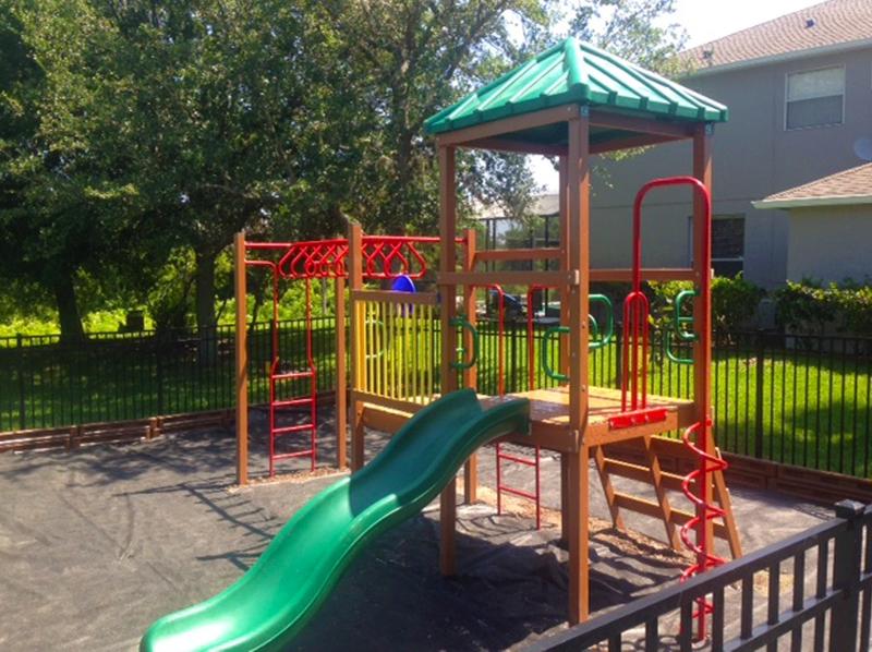 image of small community playground equipment, slide and monkey bars