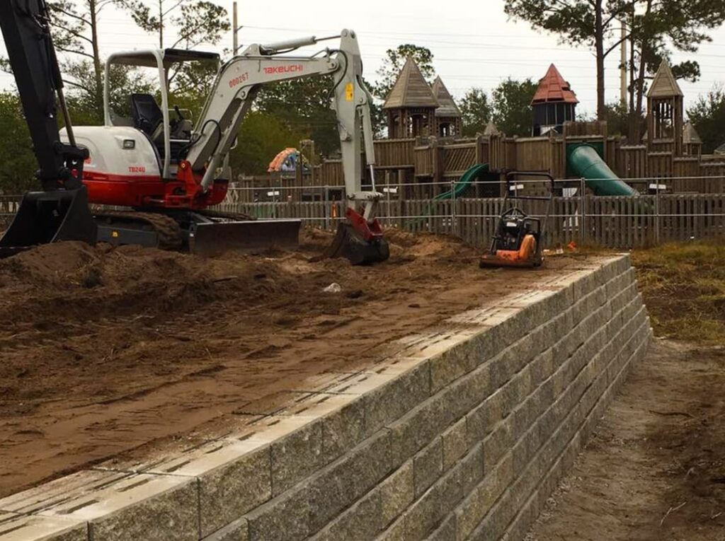 image of large construction equipment moving dirt on site for shade installation at skate park