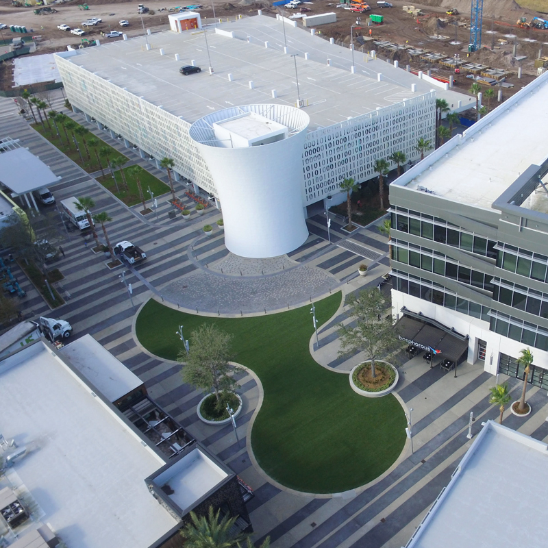 aerial of campus over grassy area that's been updated with synthetic grass turf