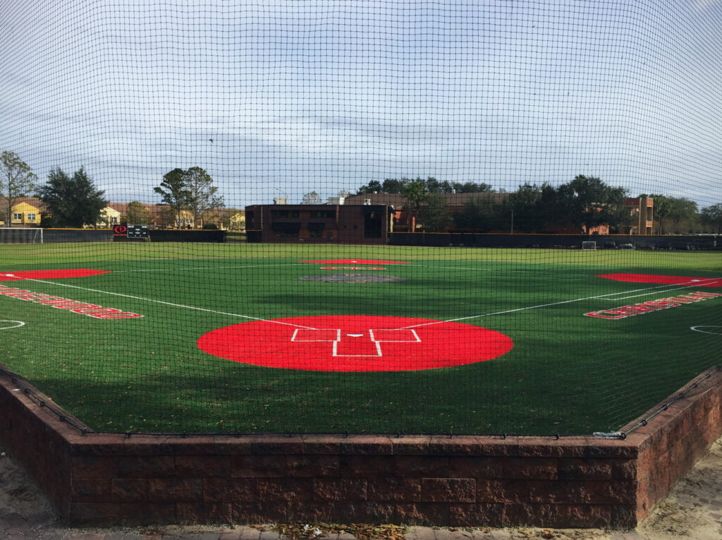 image of newly installed baseball field, from home plate, behind fence