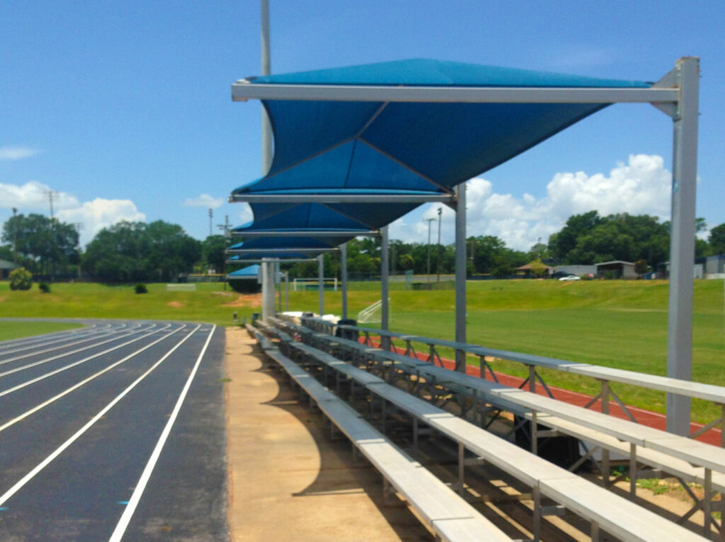 image of shades erected over bleachers area next to running track