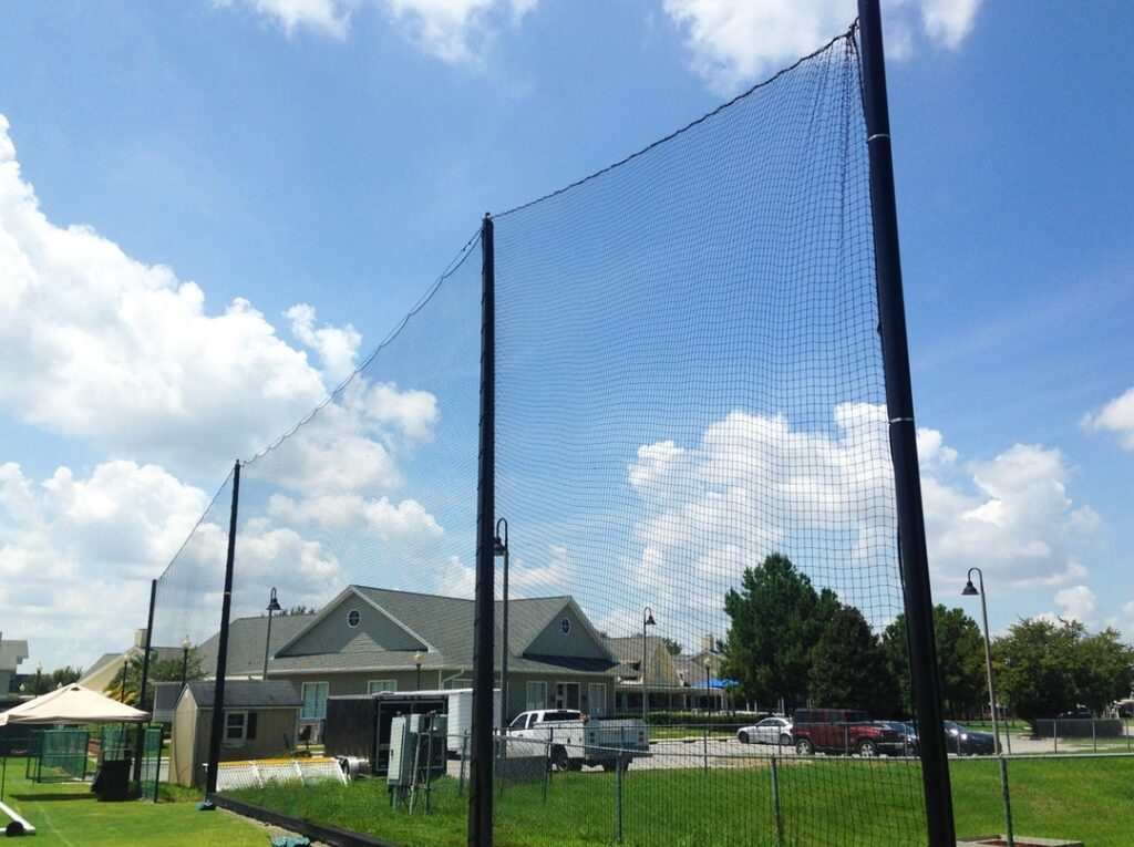 image of netting beyond baseball outfield