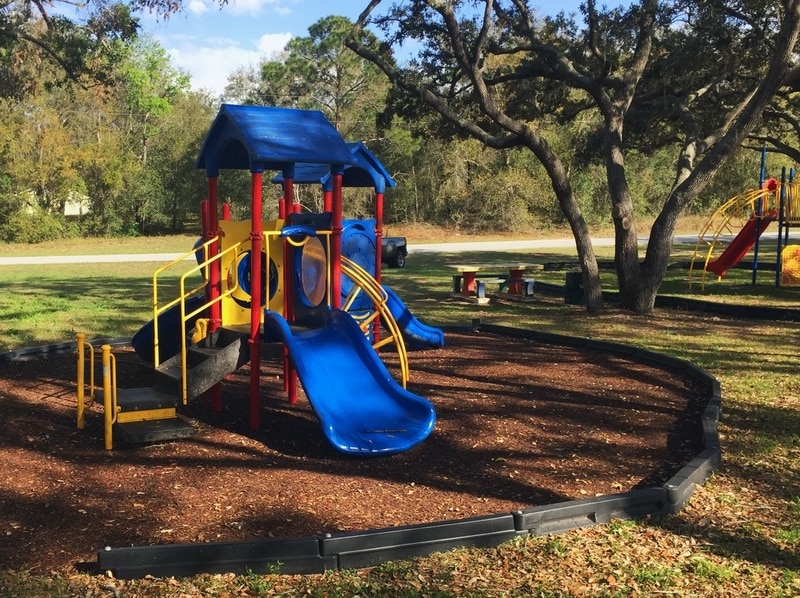 image of new playground; red, yellow and blue colors