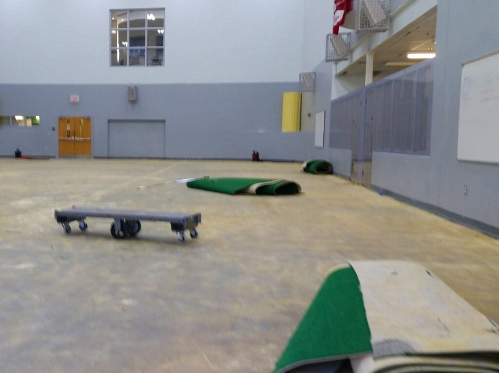 image of turf waiting to be unrolled for indoor soccer field