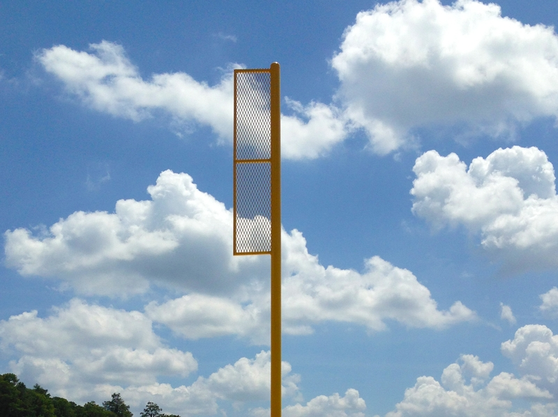 image of tall yellow pole on sports field
