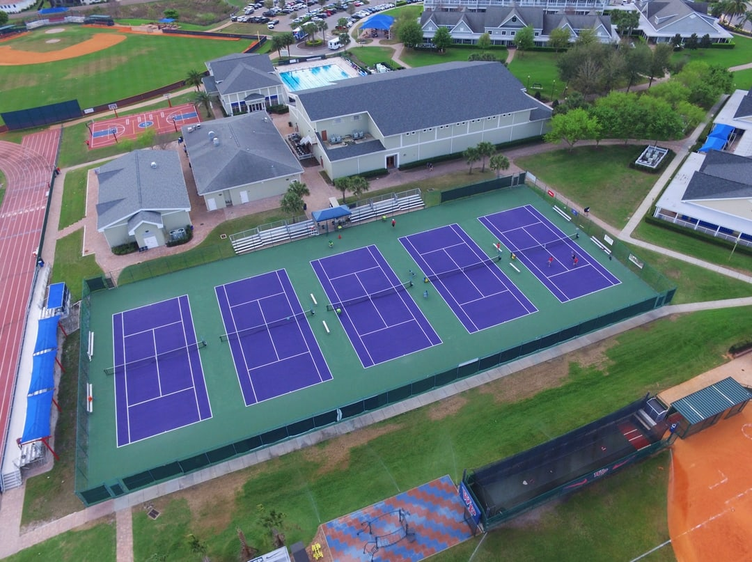 aerial image of outdoor tennis courts after resurfacing project completion