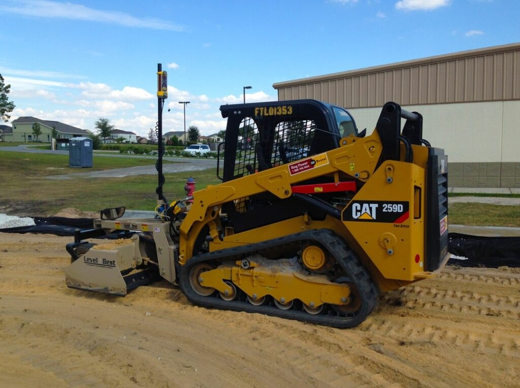 CAT maching, heavy equipment stationary on lot being developed