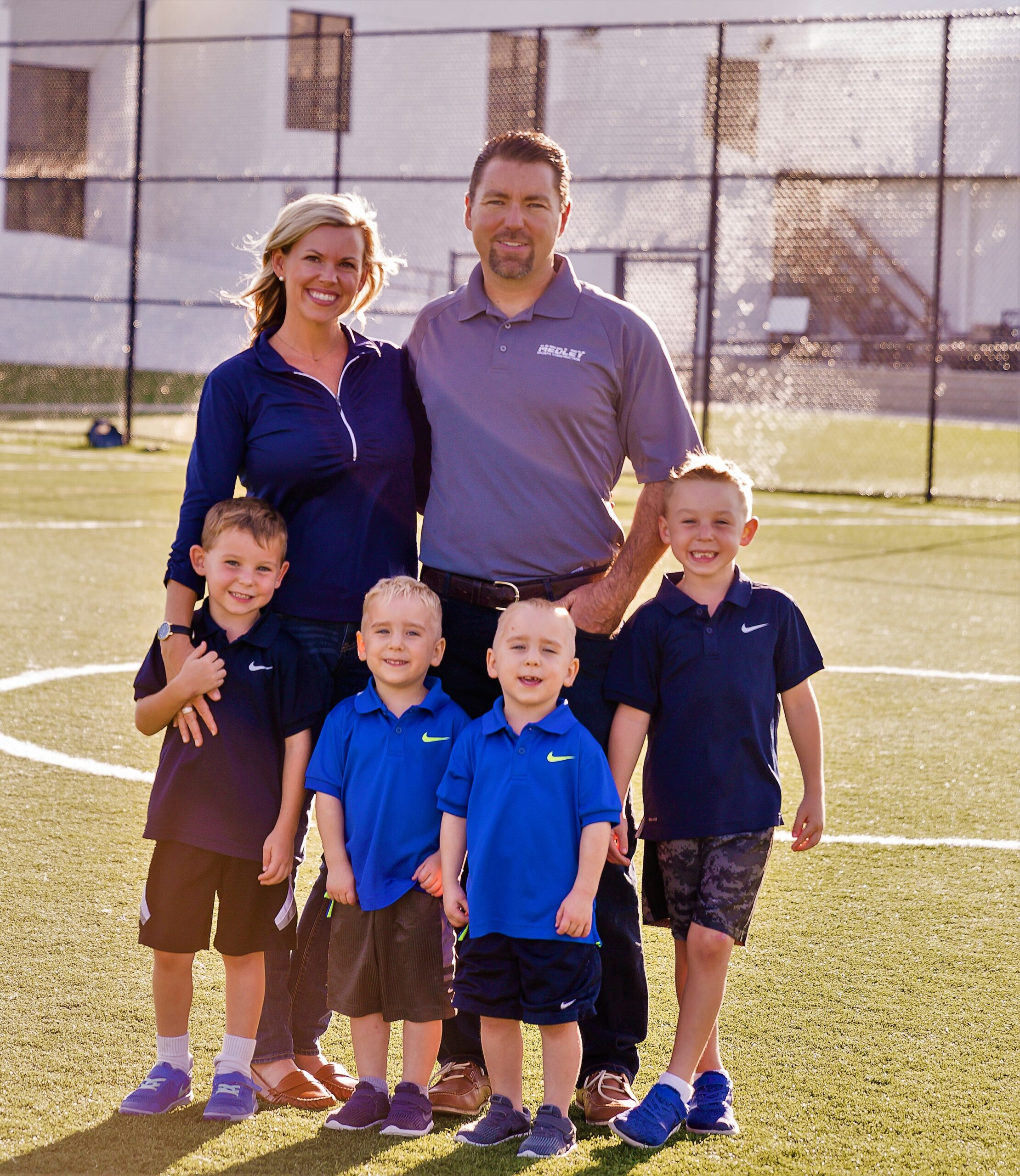 standing for photo: family of owner Erik Medley, his wife Mindy and their four boys (all under age 10, includes a set of twins)