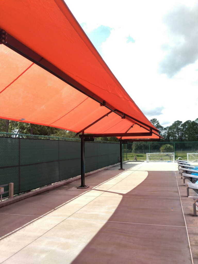 image of red shades extending length of pool deck