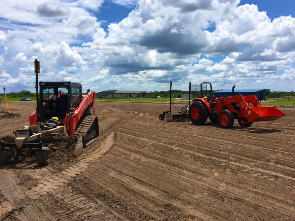 tractors performing site work and land clearing for turf field