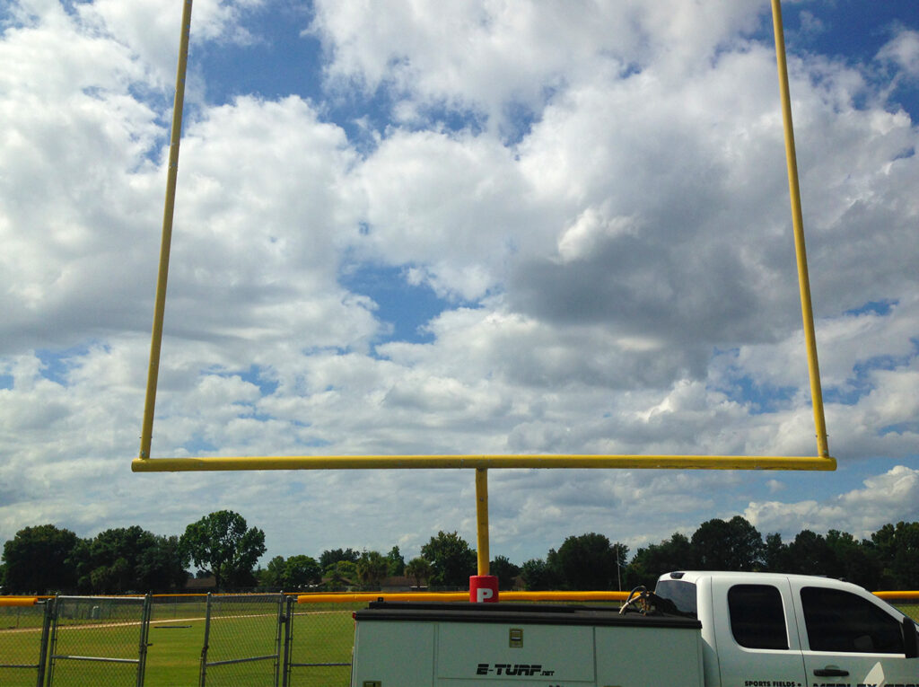 image of football goal post at Ave Maria University, goal post installation