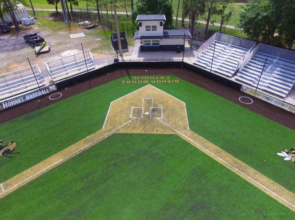 aerial image of home plate on turf baseball field