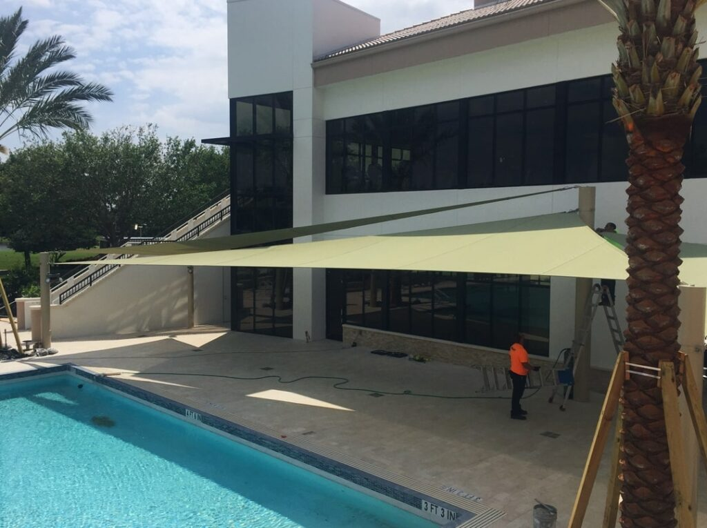 image of shade structure installation above pool deck