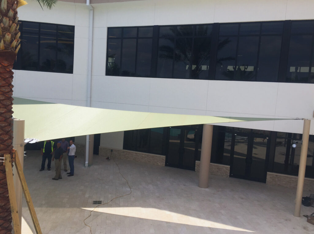 image of shade structure installation in front of a building