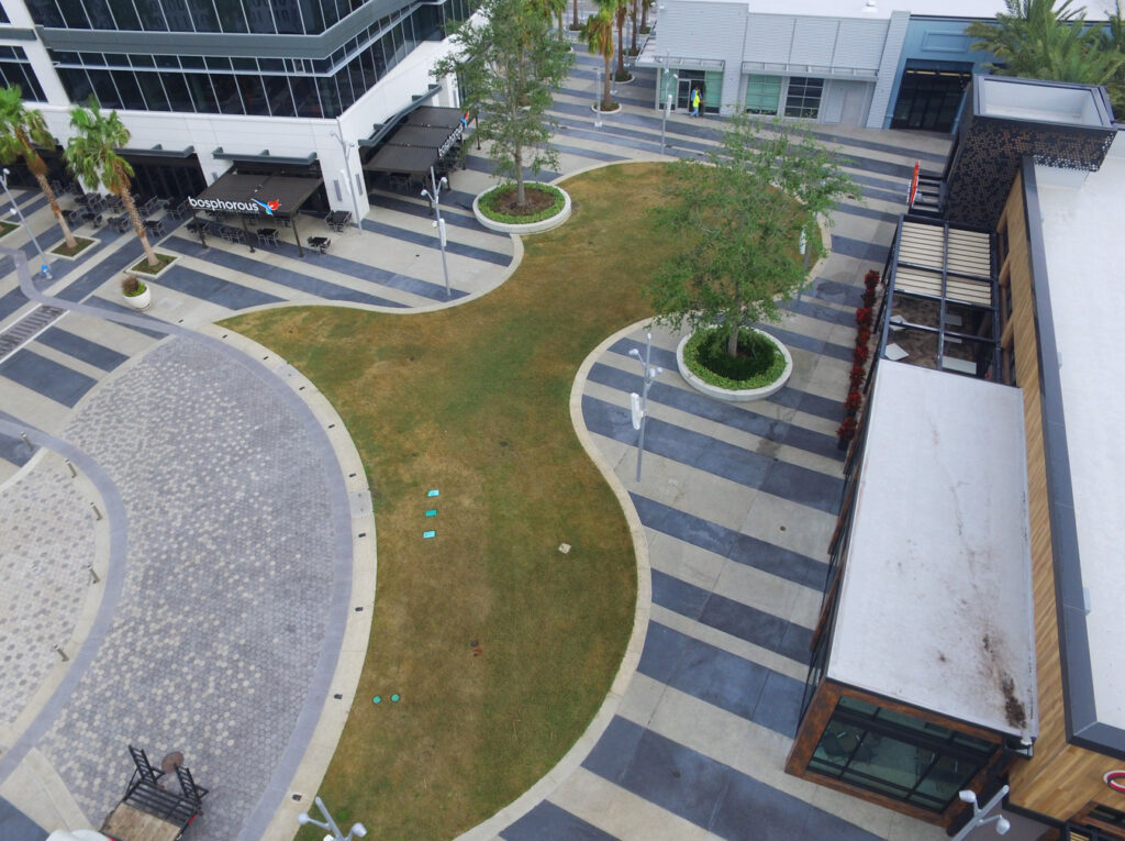 image of town center common area before turf was installed
