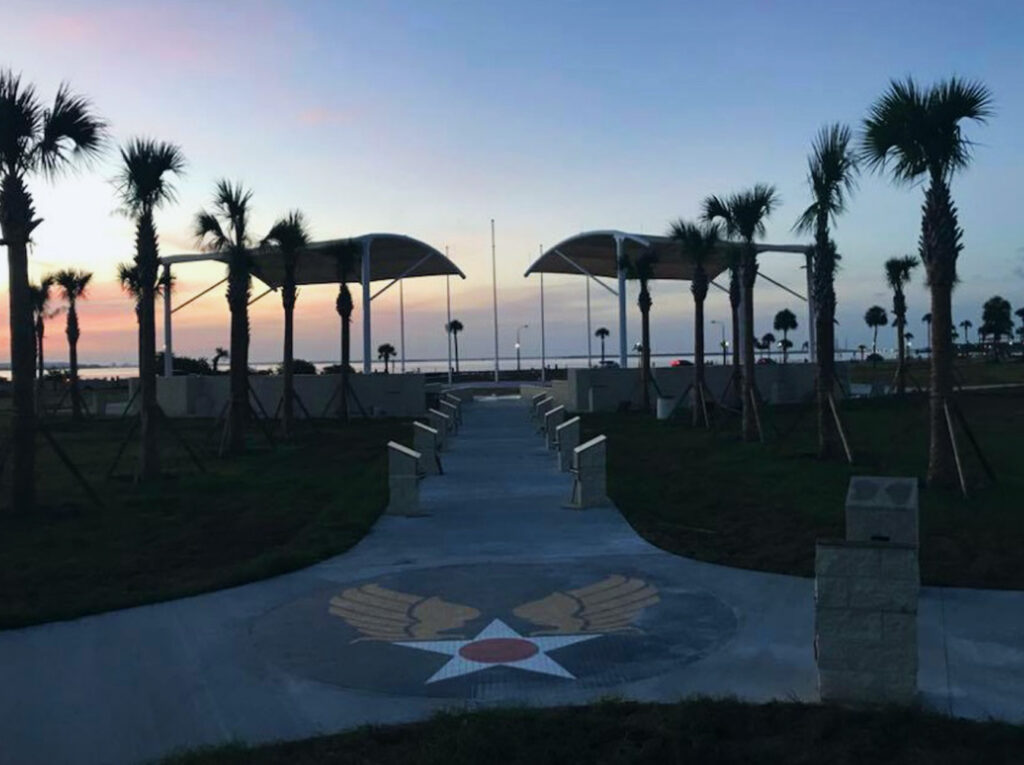 image of shade structure over memorial park at macdill airforce base at sunset