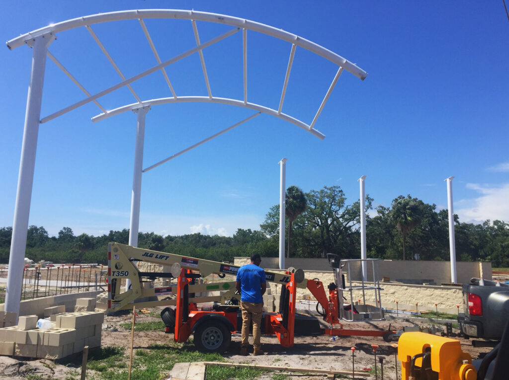 image of men working on shade structure installation