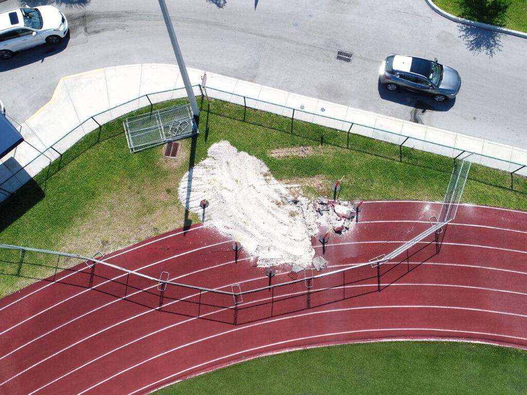 aerial image of progress on 400m track repair