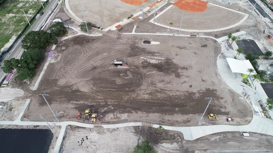 aerial image of empty lot before turning in to a turf field