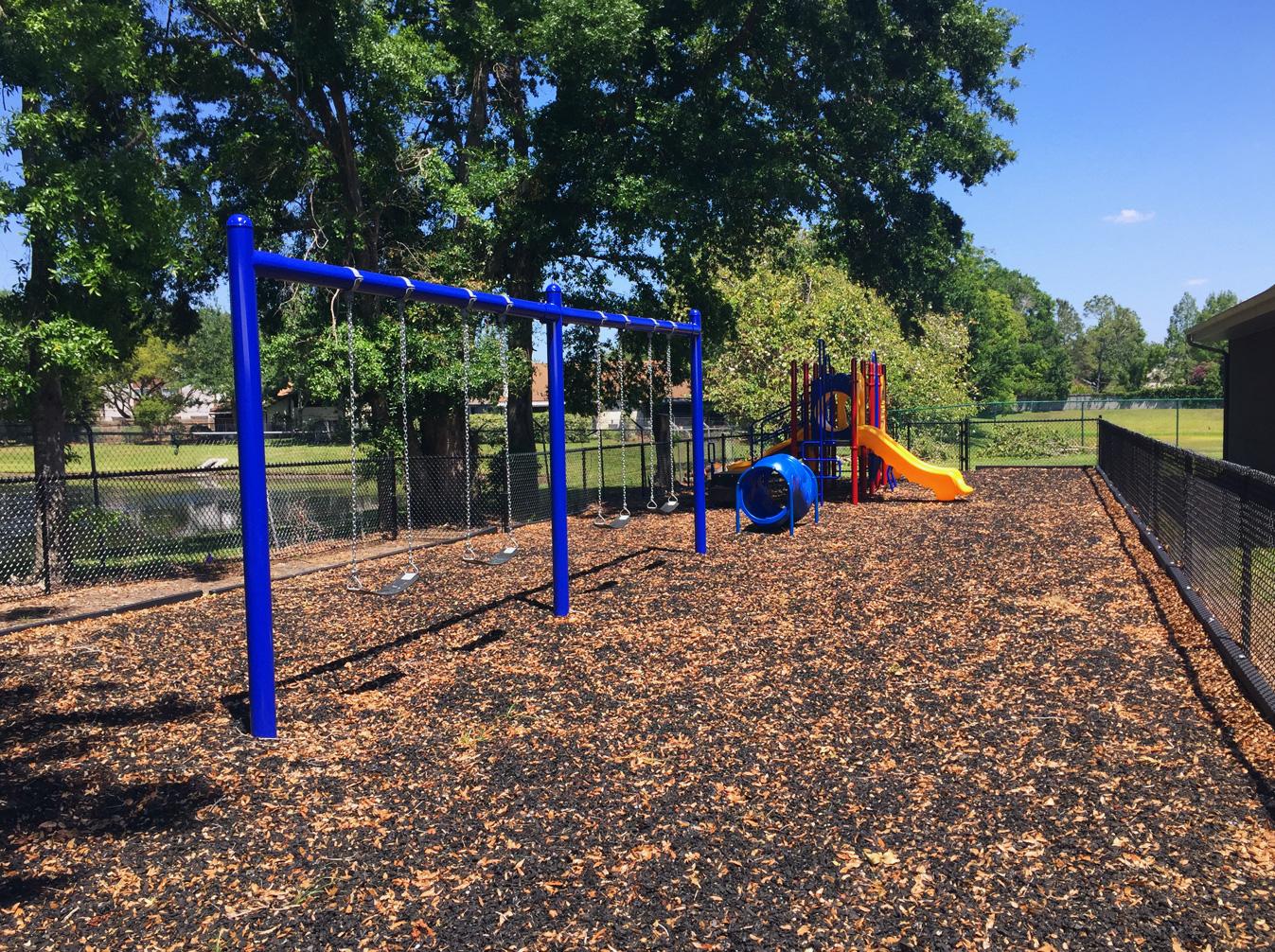 image of playground installation within gate enclosure