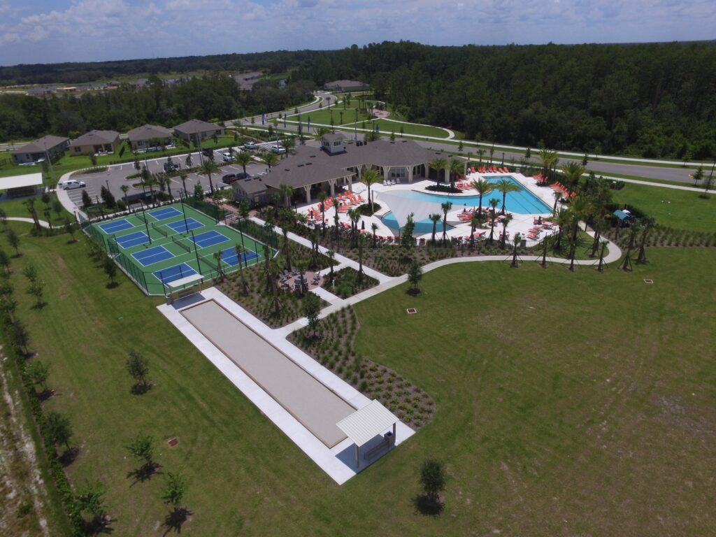 aerial of shade structure over pool deck; pickleball court