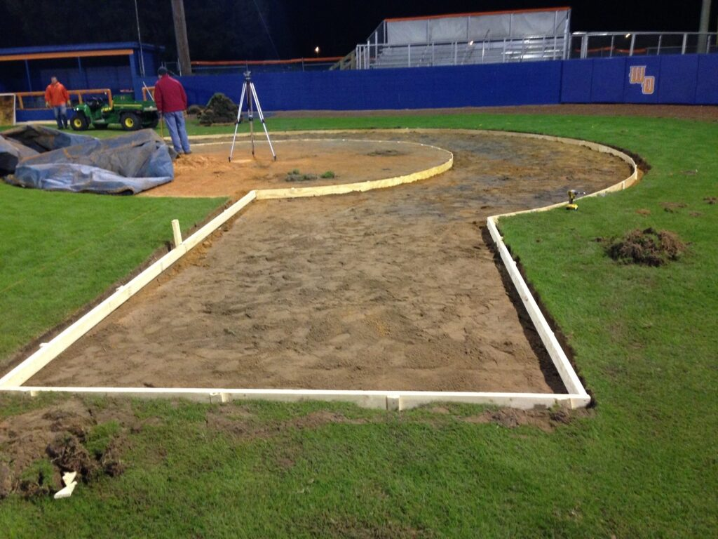 layout in ground, built of wood, for turf halo in field, night time