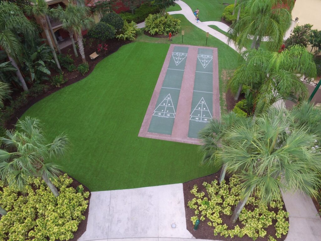 lot of land after site work and synthetic turf installation