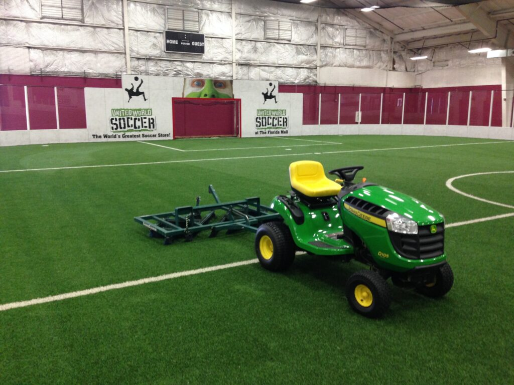 driverless tractor on top of indoor synthetic soccer field