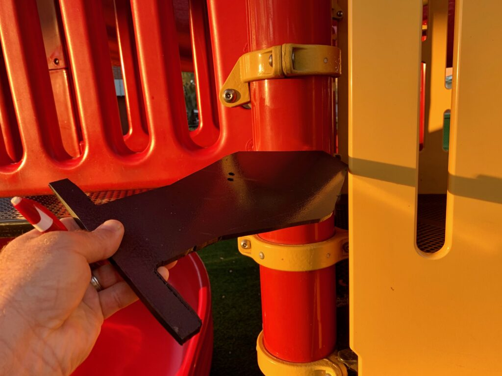 image of measuring on a playground during safety inspection