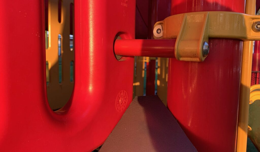closeup image of a large bolt on playground equipment